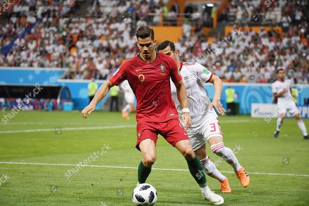 Portugal's Andre Silva (left) and Iran's Ehsan Hajsafi (right) during the match