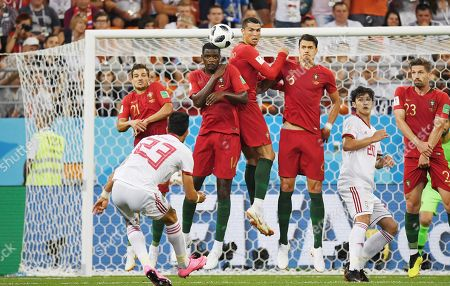 Iran's Ramin Rezaeian (left) with Portugal's players during the match