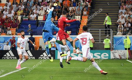 From left to right: Iran's player Ramin Rezaeian, goalkeeper Alireza Beiranvand and Portugal's Criasiano Ronaldo with Iran's player Majid Hosseini during the match