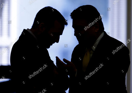 Democratic state Sens. Ben Allen, of Santa Monica, left, and Robert Hertzberg, of Van Nuys, huddle during the Senate session at the Capitol, in Sacramento, Calif