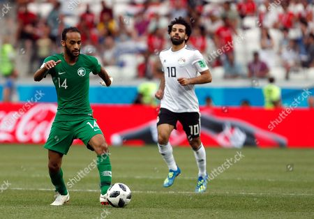 Saudi Arabia's Abdullah Otayf, left, controls the ball during the group A match between Saudi Arabia and Egypt at the 2018 soccer World Cup at the Volgograd Arena in Volgograd, Russia