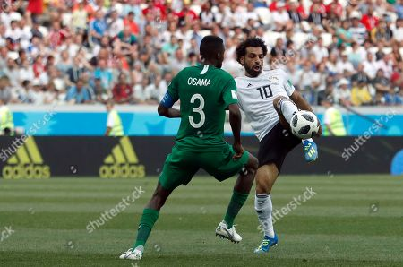 Egypt's Mohamed Salah, right, duels for the ball with Saudi Arabia's Osama Hawsawi during the group A match between Saudi Arabia and Egypt at the 2018 soccer World Cup at the Volgograd Arena in Volgograd, Russia