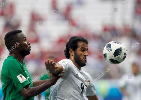 Egypt's Marwan Mohsen, right, duels for the ball with Saudi Arabia's Osama Hawsawi during the group A match between Saudi Arabia and Egypt at the 2018 soccer World Cup at the Volgograd Arena in Volgograd, Russia
