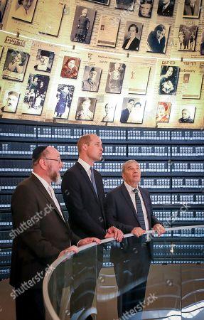 Stock Photo of Prince William tours Yad Vashem's Hall of Names with the UK's Jonathan Sacks (left).