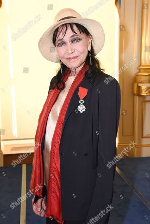Stock Picture of Anna Karina received the insignia of Knight of the Legion of Honor