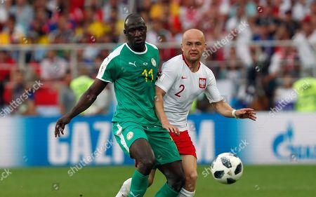 Stock Image of Senegal's Cheikh Ndoye, left, duels for the ball with Poland's Michal Pazdan during the group H match between Poland and Senegal at the 2018 soccer World Cup n the Spartak Stadium in Moscow, Russia