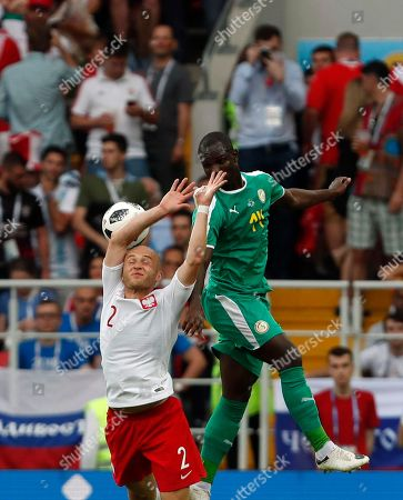 Poland's Michal Pazdan, left, duels for the ball with Senegal's Moussa Konate during the group H match between Poland and Senegal at the 2018 soccer World Cup n the Spartak Stadium in Moscow, Russia