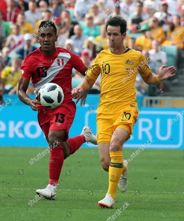 Robbie Kruse of Australia and Renato Tapia of Peru