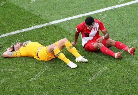 Joshua Risdon (L) of Australia reacts after a tackle during the FIFA World Cup 2018 group C preliminary round soccer match between Australia and Peru in Sochi, Russia, 26 June 2018. (RESTRICTIONS APPLY: Editorial Use Only, not used in association with any commercial entity - Images must not be used in any form of alert service or push service of any kind including via mobile alert services, downloads to mobile devices or MMS messaging - Images must appear as still images and must not emulate match action video footage - No alteration is made to, and no text or image is superimposed over, any published image which: (a) intentionally obscures or removes a sponsor identification image; or (b) adds or overlays the commercial identification of any third party which is not officially associated with the FIFA World Cup)