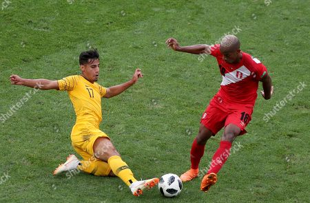 Daniel Arzani (L) of Australia and Andre Carrillo of Peru in action during the FIFA World Cup 2018 group C preliminary round soccer match between Australia and Peru in Sochi, Russia, 26 June 2018. (RESTRICTIONS APPLY: Editorial Use Only, not used in association with any commercial entity - Images must not be used in any form of alert service or push service of any kind including via mobile alert services, downloads to mobile devices or MMS messaging - Images must appear as still images and must not emulate match action video footage - No alteration is made to, and no text or image is superimposed over, any published image which: (a) intentionally obscures or removes a sponsor identification image; or (b) adds or overlays the commercial identification of any third party which is not officially associated with the FIFA World Cup)