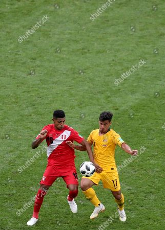 Yoshimar Yotun (L) of Peru  and Daniel Arzani of Australia in action during the FIFA World Cup 2018 group C preliminary round soccer match between Australia and Peru in Sochi, Russia, 26 June 2018. (RESTRICTIONS APPLY: Editorial Use Only, not used in association with any commercial entity - Images must not be used in any form of alert service or push service of any kind including via mobile alert services, downloads to mobile devices or MMS messaging - Images must appear as still images and must not emulate match action video footage - No alteration is made to, and no text or image is superimposed over, any published image which: (a) intentionally obscures or removes a sponsor identification image; or (b) adds or overlays the commercial identification of any third party which is not officially associated with the FIFA World Cup)