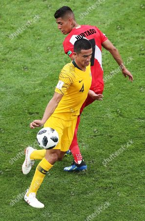 Stock Picture of Tim Cahill (L) of Australia in action against Paolo Hurtado of Peru during the FIFA World Cup 2018 group C preliminary round soccer match between Australia and Peru in Sochi, Russia, 26 June 2018. (RESTRICTIONS APPLY: Editorial Use Only, not used in association with any commercial entity - Images must not be used in any form of alert service or push service of any kind including via mobile alert services, downloads to mobile devices or MMS messaging - Images must appear as still images and must not emulate match action video footage - No alteration is made to, and no text or image is superimposed over, any published image which: (a) intentionally obscures or removes a sponsor identification image; or (b) adds or overlays the commercial identification of any third party which is not officially associated with the FIFA World Cup)