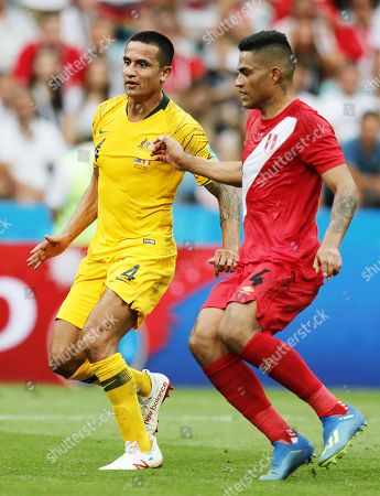 Tim Cahill (L) of Australia in action against Anderson Santamaria of Peru during the FIFA World Cup 2018 group C preliminary round soccer match between Australia and Peru in Sochi, Russia, 26 June 2018.