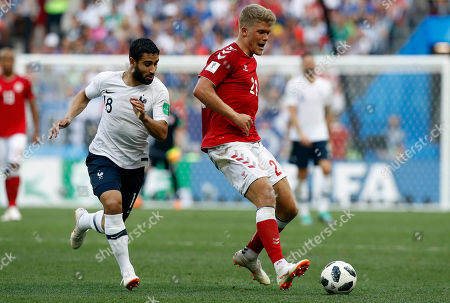 France's Nabil Fekir, left, and Denmark goalkeeper Frederik Ronnow challenge for the ball during the group C match between Denmark and France at the 2018 soccer World Cup at the Luzhniki Stadium in Moscow, Russia