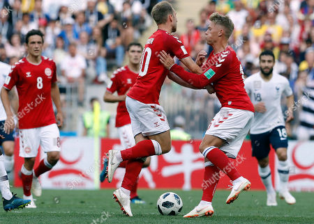 Denmark's Christian Eriksen, left, and Denmark's Viktor Fischer collide during the group C match between Denmark and France at the 2018 soccer World Cup at the Luzhniki Stadium in Moscow, Russia