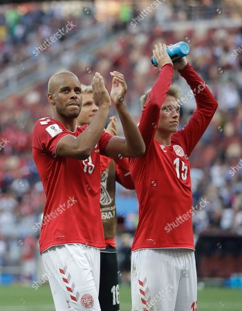 Denmark's Mathias Jorgensen,left and Denmark's Viktor Fischer applaud their teams fans after the end of the group C match between Denmark and France at the 2018 soccer World Cup at the Luzhniki Stadium in Moscow, Russia, . The game ended in a 0-0 draw