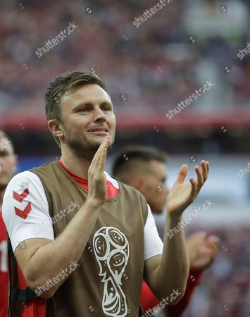 Denmark's William Kvist celebrates in front of his teams fans after the end of the group C match between Denmark and France at the 2018 soccer World Cup at the Luzhniki Stadium in Moscow, Russia, .The match ended 0-0