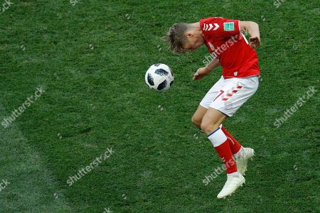 Denmark's William Kvist heads for the ball during the group C match between Denmark and France at the 2018 soccer World Cup at the Luzhniki Stadium in Moscow, Russia