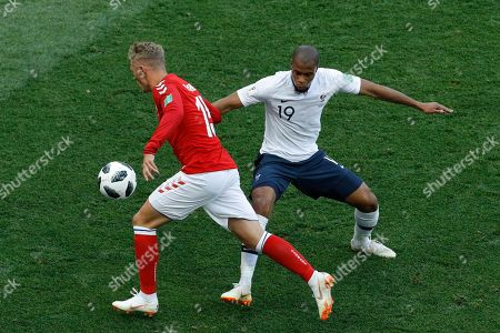 Denmark's Viktor Fischer, left, and France's Djibril Sidibe challenge for the ball during the group C match between Denmark and France at the 2018 soccer World Cup at the Luzhniki Stadium in Moscow, Russia