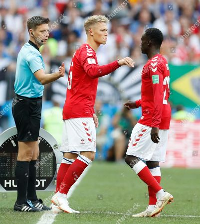 Denmark's Pione Sisto, right leaves the field of play replaced by his teammate Viktor Fischer during the group C match between Denmark and France at the 2018 soccer World Cup at the Luzhniki Stadium in Moscow, Russia