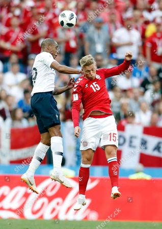 France's Djibril Sidibe, left, goes for the header with Denmark's Viktor Fischer during the group C match between Denmark and France at the 2018 soccer World Cup at the Luzhniki Stadium in Moscow, Russia
