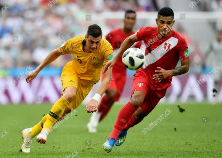 Australia's Tomi Juric, left, and Peru's Anderson Santamaria challenge for the ball during the group C match between Australia and Peru, at the 2018 soccer World Cup in the Fisht Stadium in Sochi, Russia
