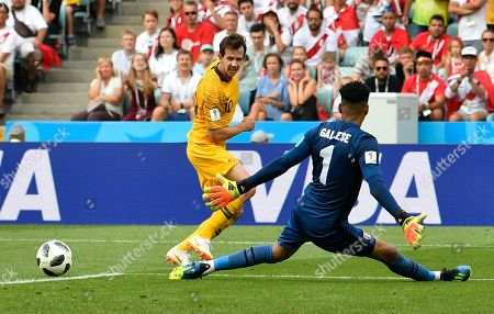 Australia's Robbie Kruse, left, plays a cross past Peru goalkeeper Pedro Gallese during the group C match between Australia and Peru, at the 2018 soccer World Cup in the Fisht Stadium in Sochi, Russia