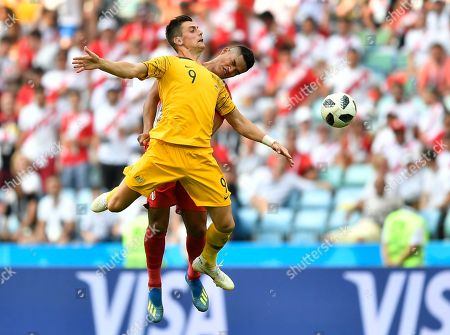 Peru's Anderson Santamaria, background, and Australia's Tomi Juric go for a header during the group C match between Australia and Peru, at the 2018 soccer World Cup in the Fisht Stadium in Sochi, Russia