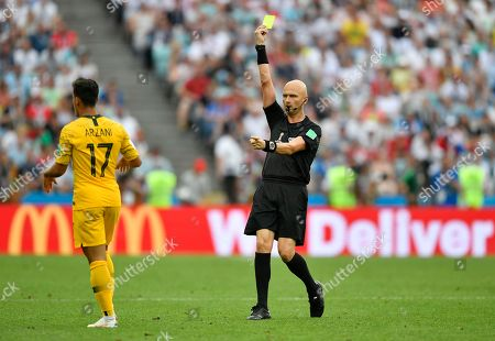 Australia's Daniel Arzani is booked by referee Sergey Karasev from Russia during the group C match between Australia and Peru, at the 2018 soccer World Cup in the Fisht Stadium in Sochi, Russia