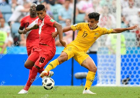 Peru's Christian Ramos, left, and Australia's Daniel Arzani challenge for the ball during the group C match between Australia and Peru, at the 2018 soccer World Cup in the Fisht Stadium in Sochi, Russia
