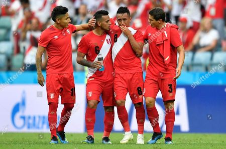 Peru's Christian Cueva, second right, is comforted by his teammates Raul Ruidiaz, Miguel Trauco and Aldo Corzo, from left, after the group C match between Australia and Peru, at the 2018 soccer World Cup in the Fisht Stadium in Sochi, Russia