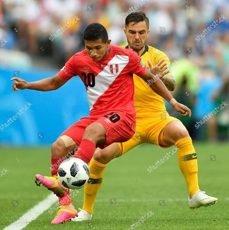 Peru's Edison Flores, left, and Australia's Joshua Risdon challenge for the ball during the group C match between Australia and Peru, at the 2018 soccer World Cup in the Fisht Stadium in Sochi, Russia