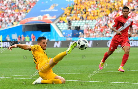 Australia's Joshua Risdon goes for a ball as Peru's Edison Flores, right looks on during the group C match between Australia and Peru, at the 2018 soccer World Cup in the Fisht Stadium in Sochi, Russia