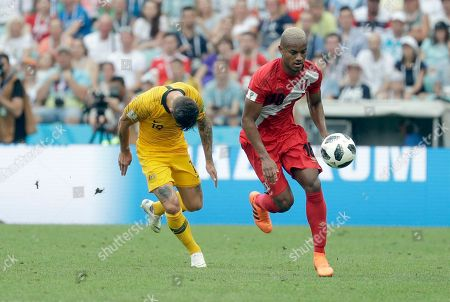 Peru's Andre Carrillo, right, fights for the ball with Australia's Joshua Risdon during the group C match between Australia and Peru, at the 2018 soccer World Cup in the Fisht Stadium in Sochi, Russia