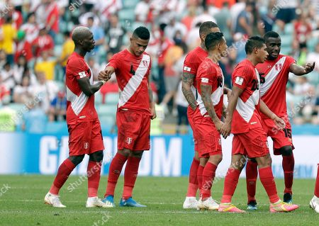 Peru's Andre Carrillo, left and Peru's Anderson Santamaria, second left hold their hands during the group C match between Australia and Peru, at the 2018 soccer World Cup in the Fisht Stadium in Sochi, Russia