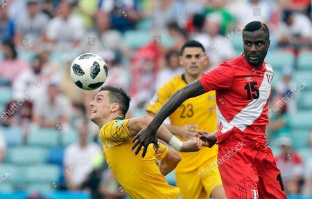 Australia's Tomi Juric, left, fights for the ball with Peru's Christian Ramos during the group C match between Australia and Peru, at the 2018 soccer World Cup in the Fisht Stadium in Sochi, Russia