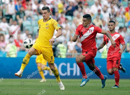 Australia's Tomi Juric, left, fights for the ball with Peru's Anderson Santamaria during the group C match between Australia and Peru, at the 2018 soccer World Cup in the Fisht Stadium in Sochi, Russia