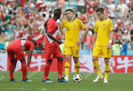 Australia's Tom Rogic, center and Australia's Tomi Juric, right, react after Peru's Paolo Guerrero scored his side' second goal during the group C match between Australia and Peru, at the 2018 soccer World Cup in the Fisht Stadium in Sochi, Russia