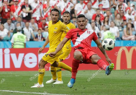 Peru's Anderson Santamaria, right, fights for the ball with Australia's Tim Cahill during the group C match between Australia and Peru, at the 2018 soccer World Cup in the Fisht Stadium in Sochi, Russia