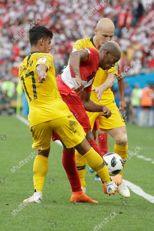 Peru's Andre Carrillo, center fights for the ball with Australia's Daniel Arzani, left and Australia's Aaron Mooy during the group C match between Australia and Peru, at the 2018 soccer World Cup in the Fisht Stadium in Sochi, Russia
