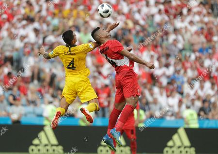 Australia's Tim Cahill, left and Peru's Anderson Santamaria are airborne during the group C match between Australia and Peru, at the 2018 soccer World Cup in the Fisht Stadium in Sochi, Russia