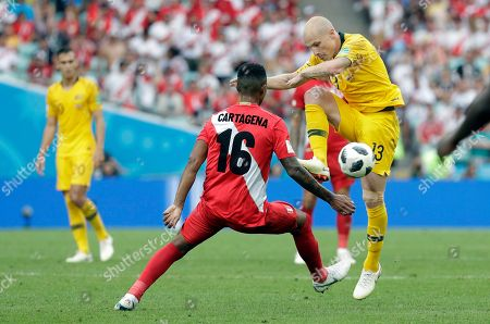 Stock Image of Australia's Jamie Maclaren, right, fights for the ball with Peru's Wilder Cartagena during the group C match between Australia and Peru, at the 2018 soccer World Cup in the Fisht Stadium in Sochi, Russia