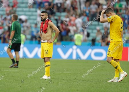 Australia's Aziz Behich, left and Australia's Tomi Juric react at the end of the group C match between Australia and Peru, at the 2018 soccer World Cup in the Fisht Stadium in Sochi, Russia