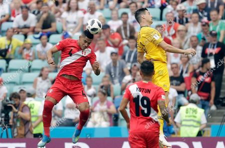 Peru's Anderson Santamaria, left, heads the ball during the group C match between Australia and Peru, at the 2018 soccer World Cup in the Fisht Stadium in Sochi, Russia