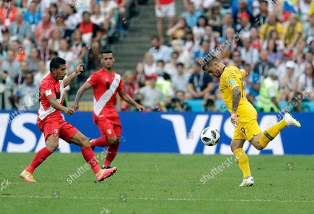Australia's Joshua Risdon, right, kicks the ball during the group C match between Australia and Peru, at the 2018 soccer World Cup in the Fisht Stadium in Sochi, Russia