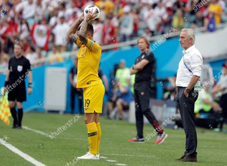 Australia's Joshua Risdon throws the ball as Australia head coach Bert van Marwijk looks on during the group C match between Australia and Peru, at the 2018 soccer World Cup in the Fisht Stadium in Sochi, Russia