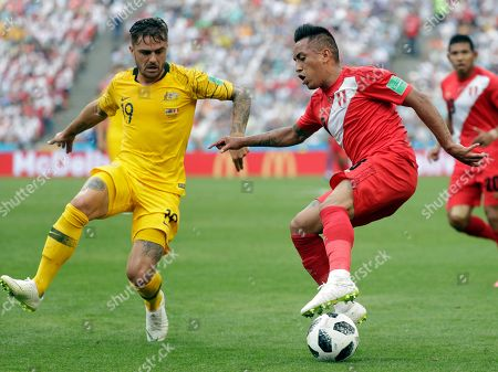 Australia's Joshua Risdon, left, fights for the ball with Peru's Christian Cueva during the group C match between Australia and Peru, at the 2018 soccer World Cup in the Fisht Stadium in Sochi, Russia