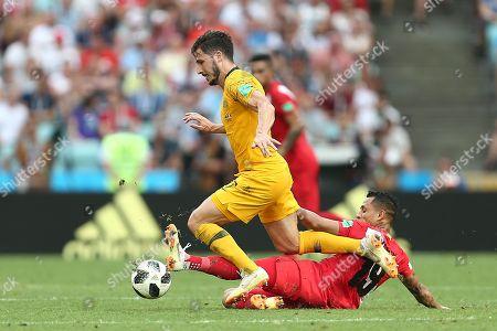 Daniel Arzani of Australia is tackled by Yoshimar Yotun of Peru