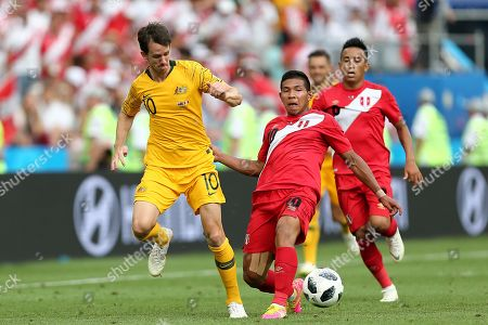Robbie Kruse of Australia is tackled by Jefferson Farfan of Peru