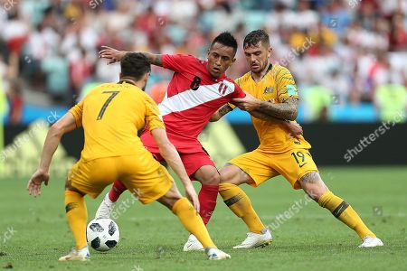 Stock Photo of Christian Cueva of Peru is tackled by Matthew Leckie and Joshua Risdon of Australia